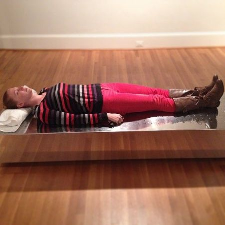 Young woman laying on Valeska Soares' Fainting Couch at the Philips Gallery