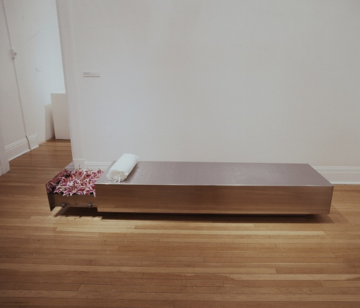 Drawer where the stargazer lilies are stored is opened to reveal the lilies that fill the Soares piece Fainting Couch